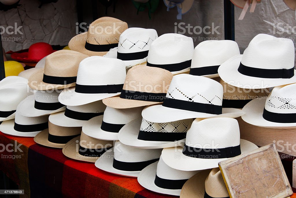 Stacks of Hats in a Marketplace stock photo