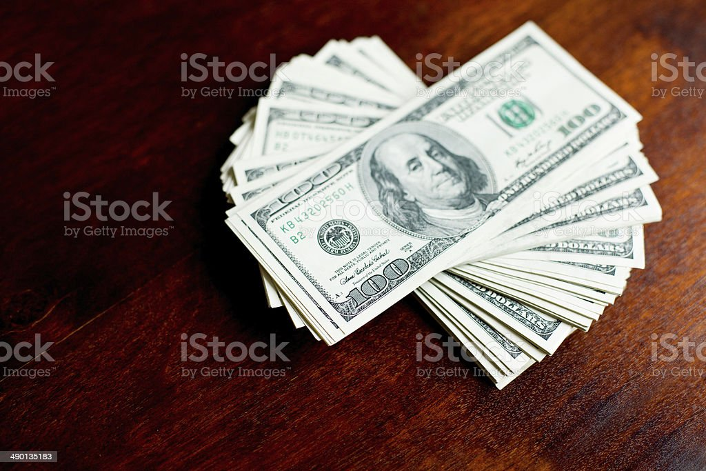 Stacks of one hundred dollars banknotes stock photo