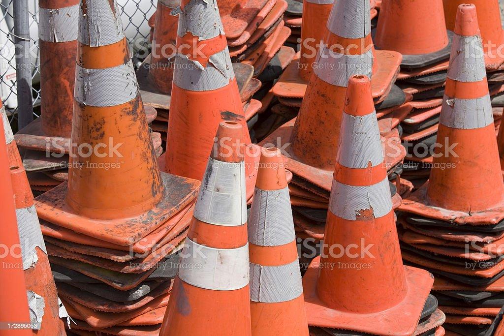 Stacks of orange traffic construction cones royalty-free stock photo