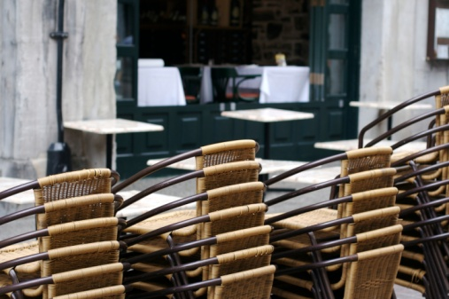 Stacks of outdoor chairs awaiting tourists
