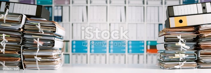istock Stacks of paperwork in the office 915657890