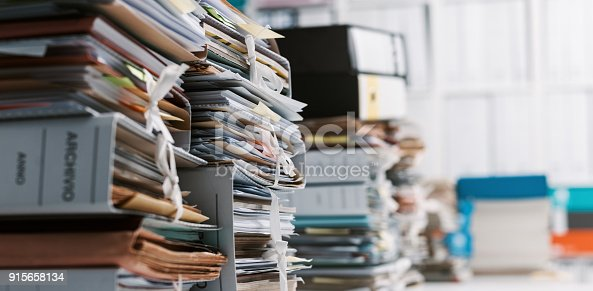 istock Stacks of paperwork in the office 915658134