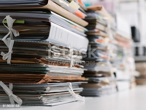 istock Stacks of paperwork in the office 915658168