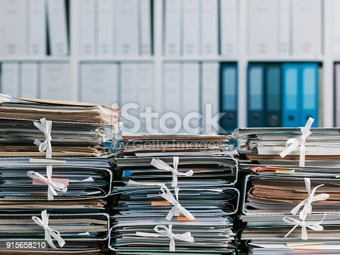 istock Stacks of paperwork in the office 915658210