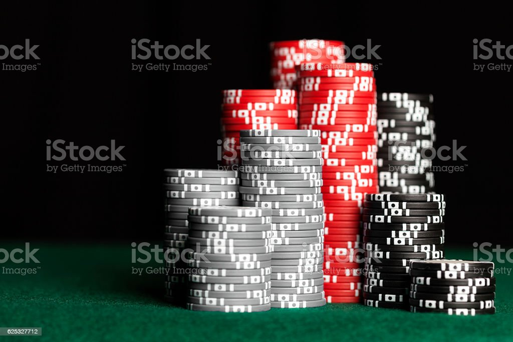 Stacks of poker chips on table stock photo