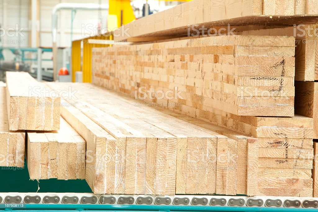Stacks of processed wood planks at a lumber yard stock photo