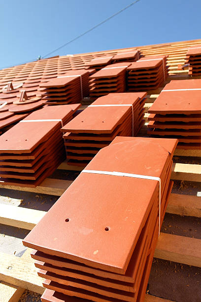 Stacks of roof tiles stock photo