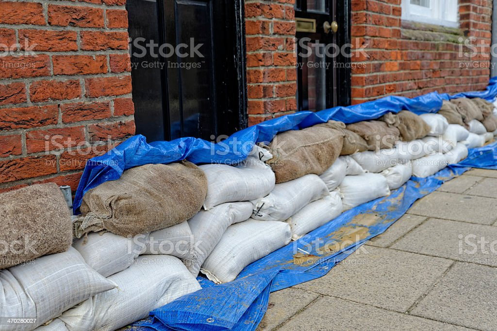 Stacks of sandbags outside a front door of home for flooding stock photo