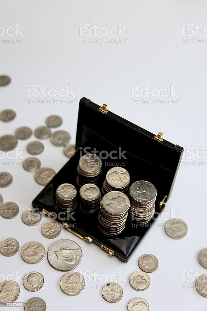 Stacks of Silver Coins in a Briefcase stock photo