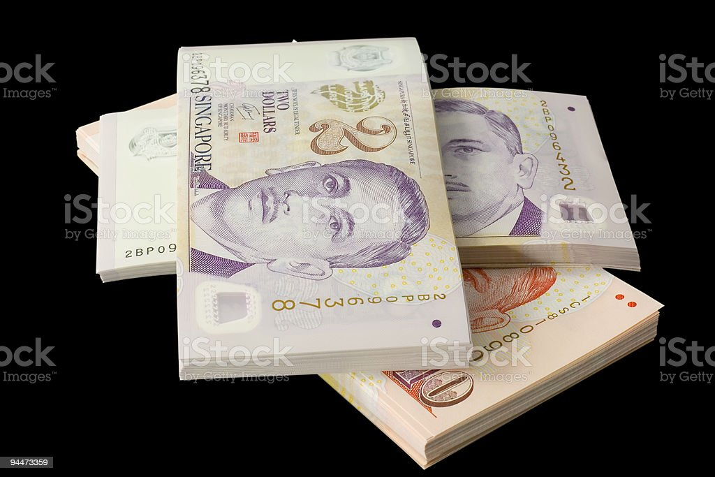 Stacks of Singapore currency stock photo