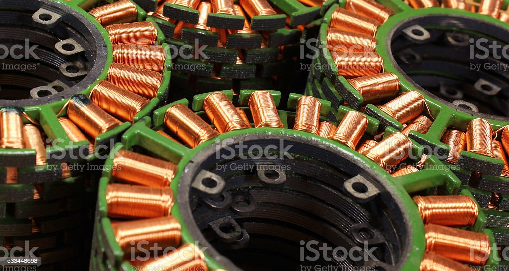 Stacks of stators from old disassembled brushless electric motor stock photo