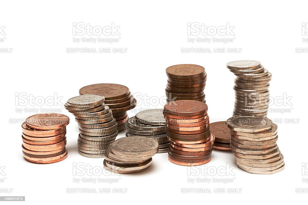 Stacks of UK coins isolated on white background. stock photo