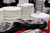 stacks of white plates and kitchen utensils