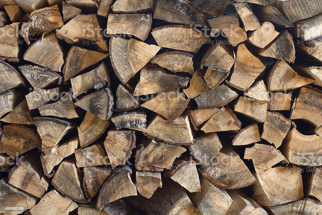 Stacks of wood in woodpile royalty-free stock photo