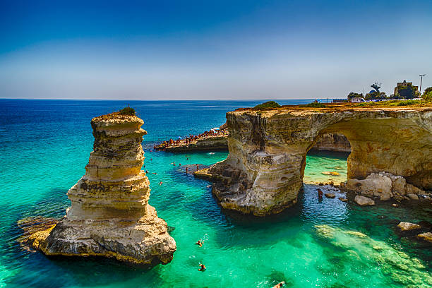 Stacks on the coast of Salento in Italy stock photo