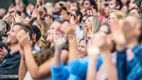 istock Stadium crowd cheering and clapping 1127427788