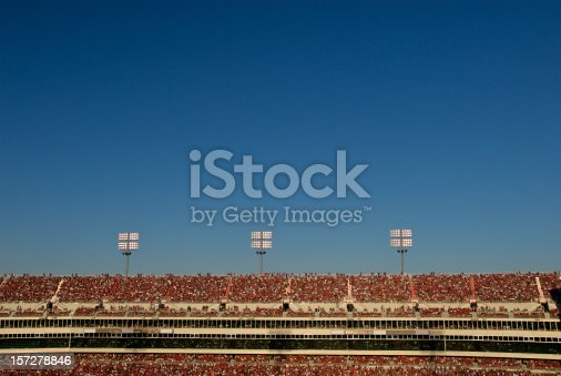 istock Stadium Crowd Under Blue Sky 157278846