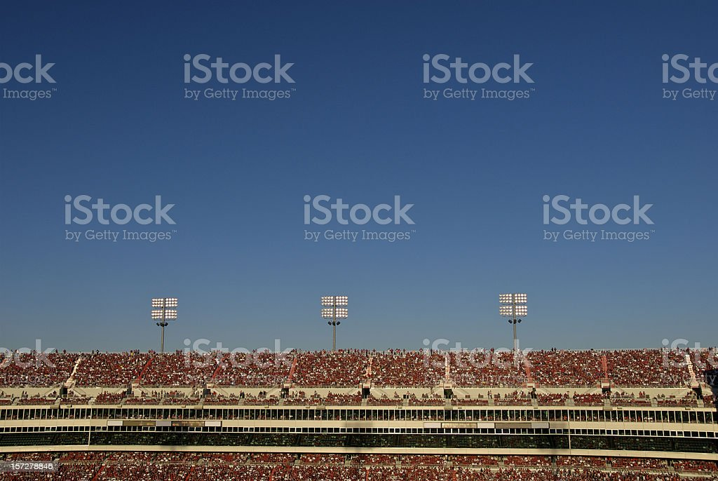 Stadium Crowd Under Blue Sky stock photo
