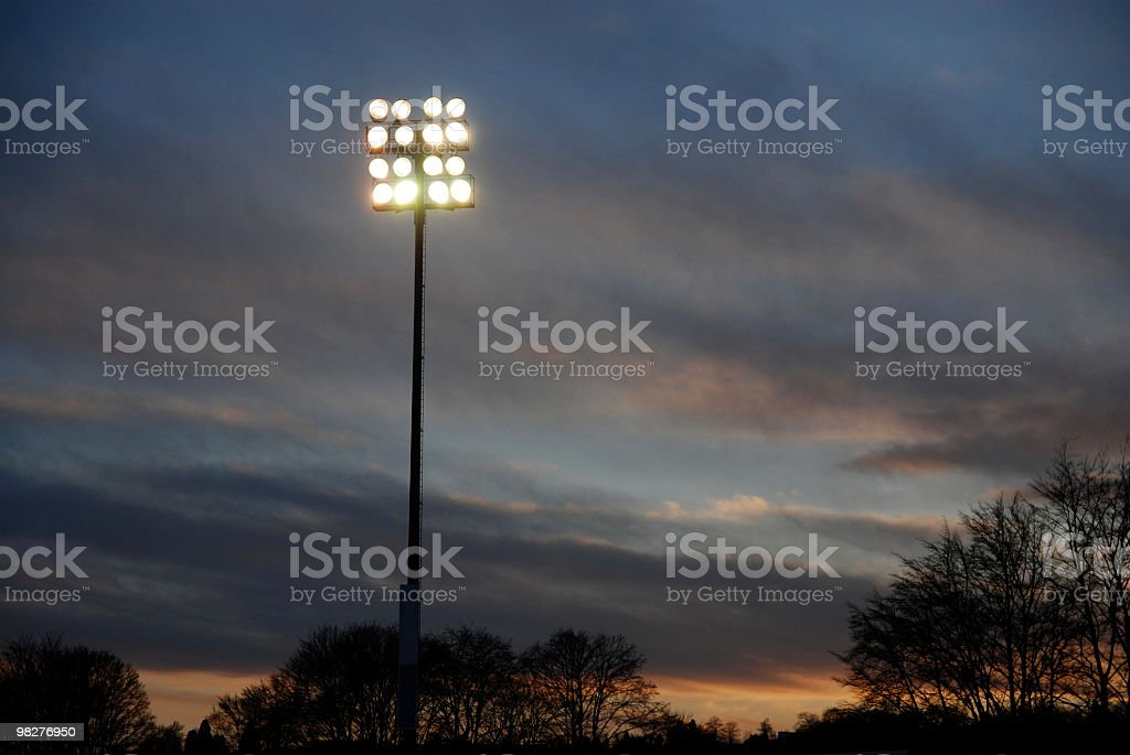 stadium floodlight at dawn royalty-free stock photo