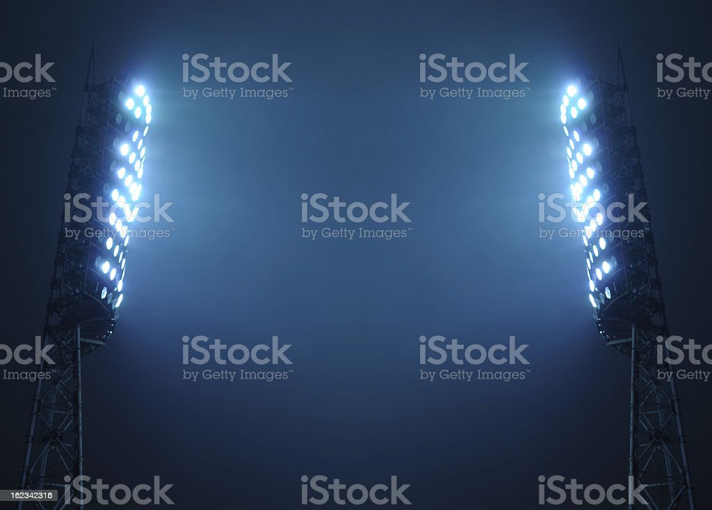 Stadium Floodlights against Dark Night Sky stock photo
