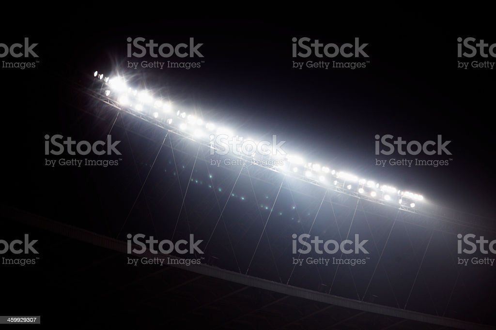 Stadium floodlights shining in darkness in Beijing, China stock photo