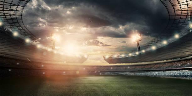 estádio em luzes e flashes, campo de futebol. conceito de esportes fundo, futebol, estádio de noite. misturado mídia, copie o espaço. - estádio - fotografias e filmes do acervo