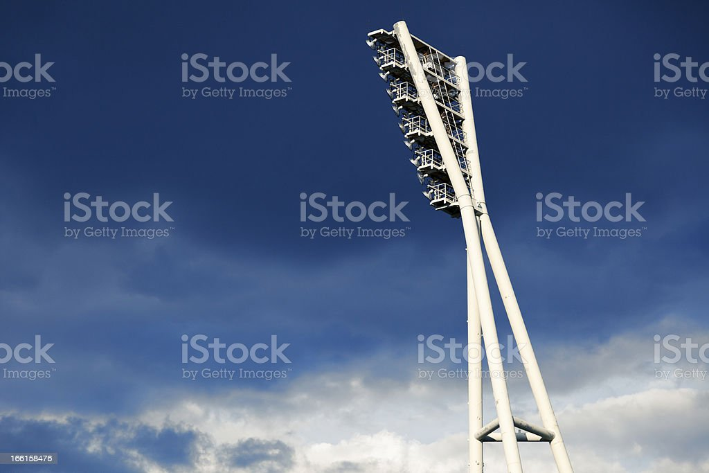 Stadium Lighting Tower and Cloudy Sky royalty-free stock photo