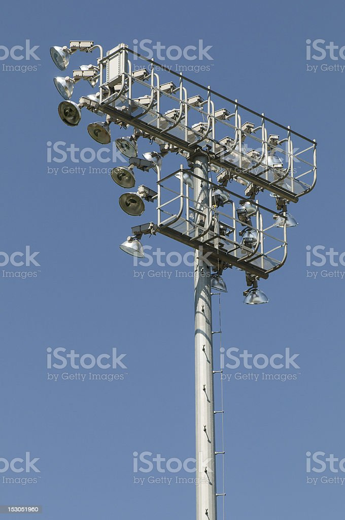 Stadium lights against a blue sky royalty-free stock photo