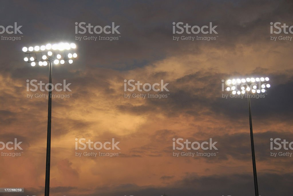 Stadium Lights Against Sunset Backdrop royalty-free stock photo