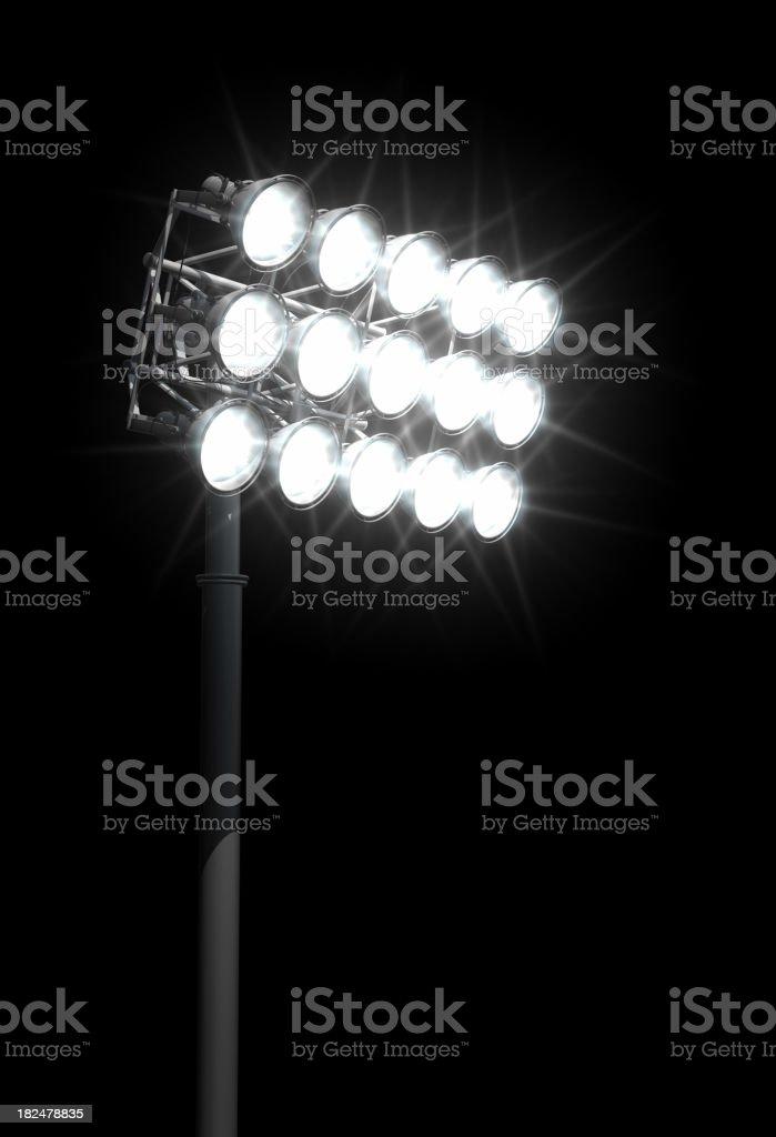 Stadium lights aimed down at the football field royalty-free stock photo