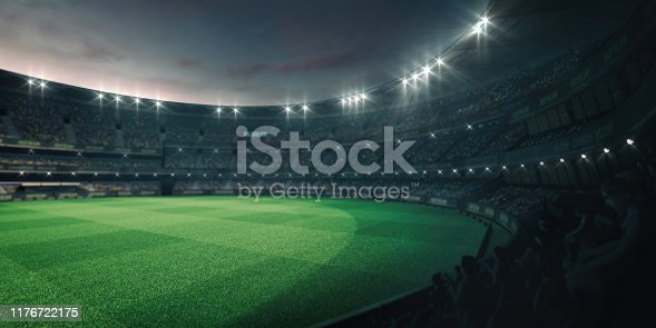 istock Stadium lights and empty green grass field with fans around, perspective tribune view 1176722175
