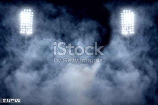 istock stadium lights and smoke 518177420
