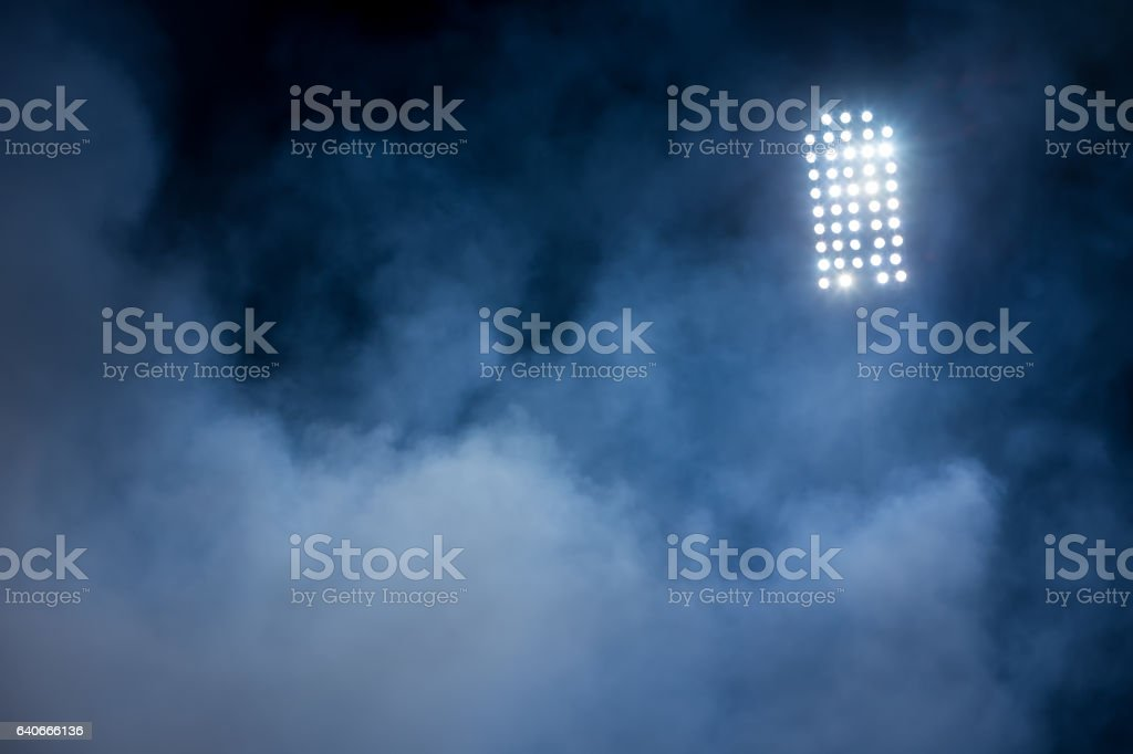 stadium lights and smoke stock photo
