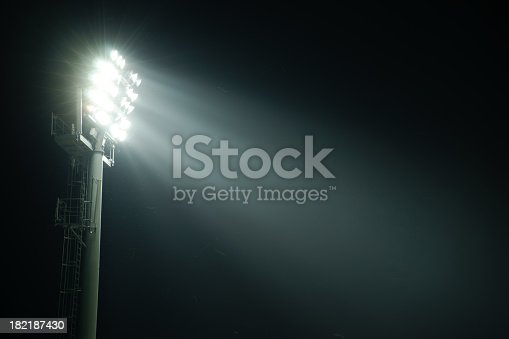 Stadium lights from side illuminating space for your text. Flies flying around the lights.My other similar images in