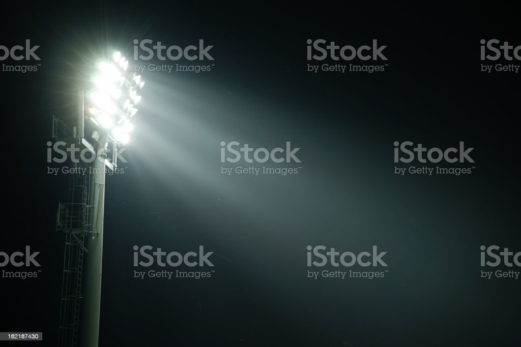 A stadium lights at night from the side stock photo