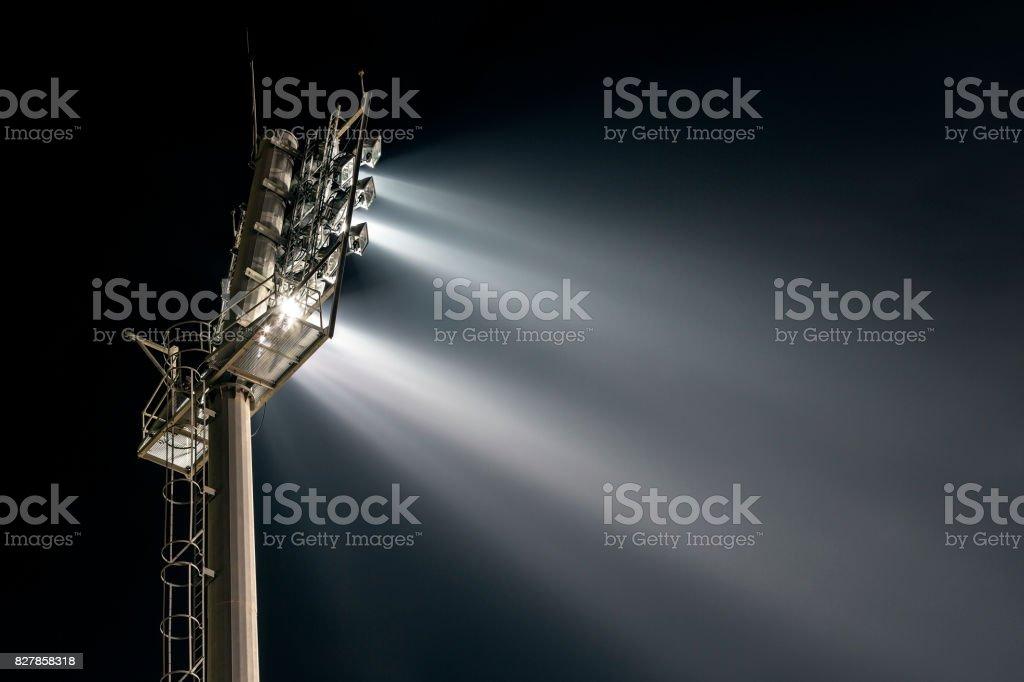 Stadium lights from behind stock photo