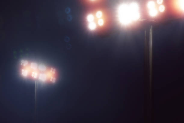 stadium lights in sport game in dark night sky background - baseball sport stock photos and pictures
