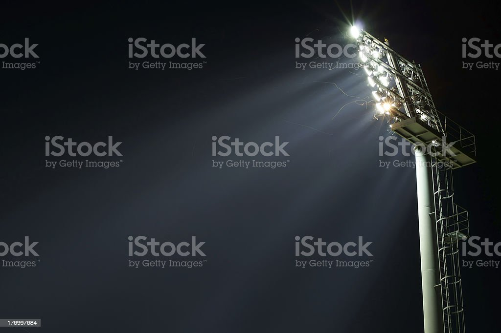 Stadium lights turned on and some insects at night stock photo