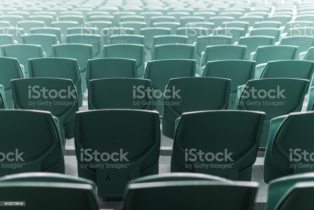 Stadium plastic chairs in rows of abstract pattern stock photo