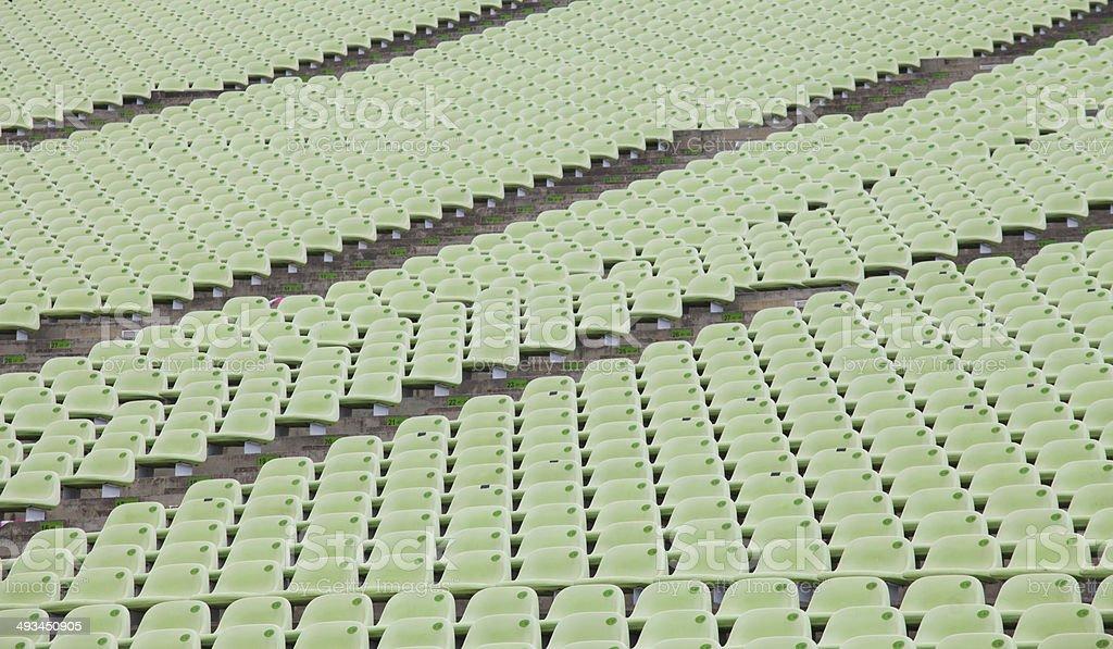 Stadium seats in green color stock photo