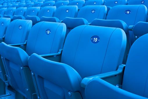 171581046 istock photo Stadium seats. 182734315