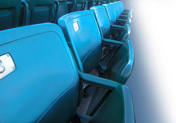 Stadium Seats A row of baseball stadium steats along a white background. ncaa college football stock pictures, royalty-free photos & images