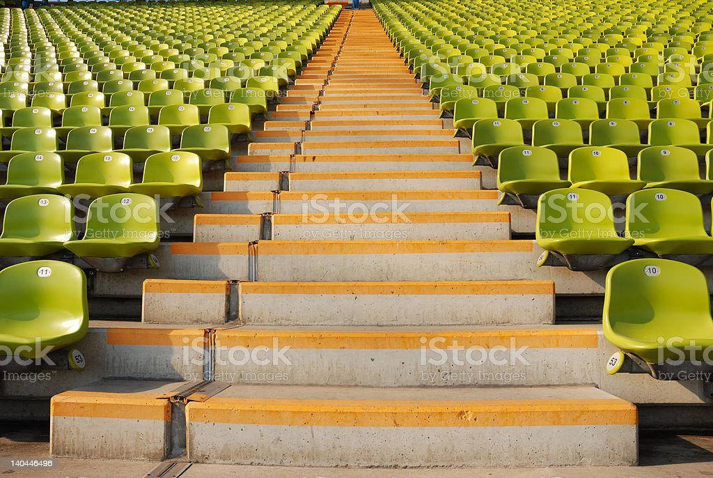 stadium steps and rows of green seats stock photo