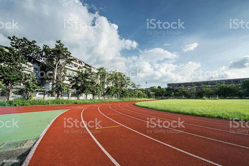 Stadium track and field area empty on a sunny day stock photo