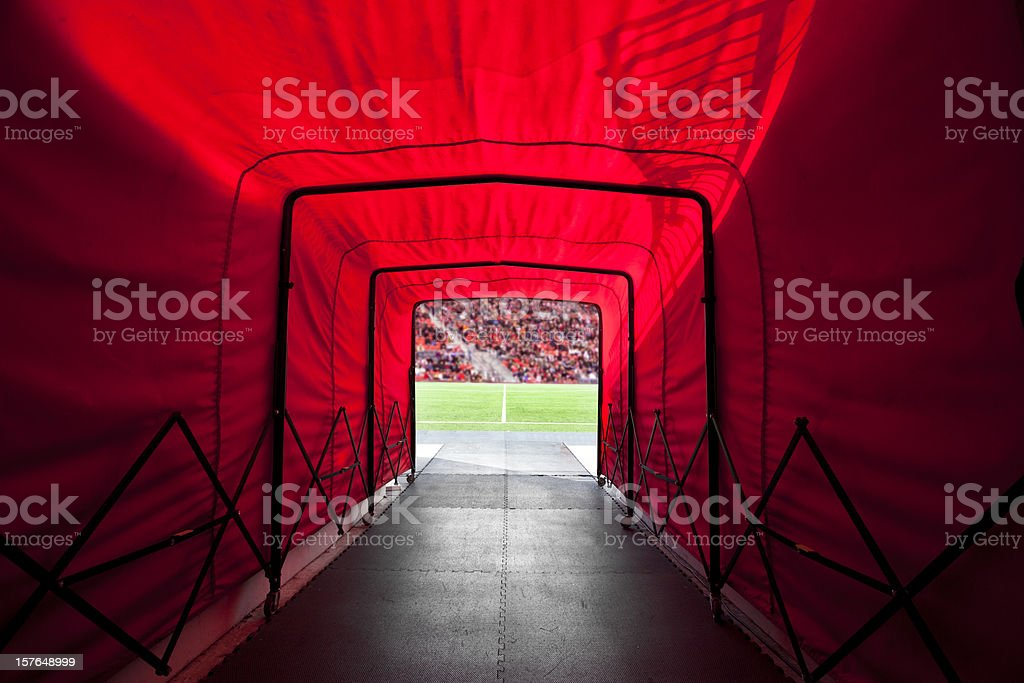 Stadium tunnel onto the field stock photo