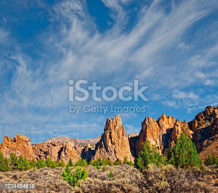 Staender Ridge and The Monument are rock formations above the Crooked River Gorge near Smith Rock.  This scene was photographed at Smith Rock State Park near the town of Terrebonne, Oregon, USA.