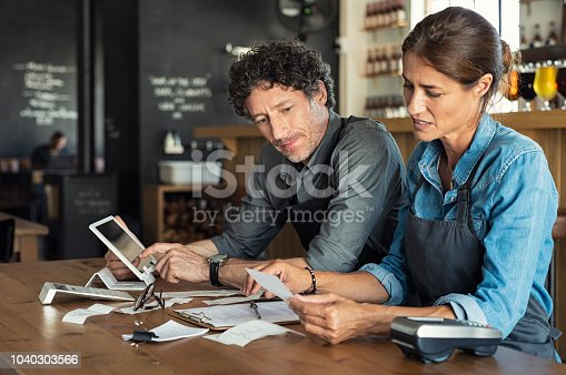 istock Staff calculating restaurant bill 1040303566