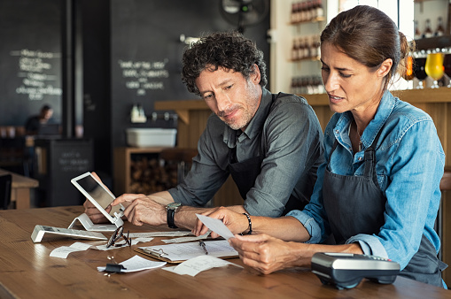 Staff Calculating Restaurant Bill Stock Photo - Download Image Now