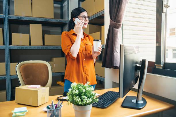 staff chatting on smartphone while taking break - call center стоковые фото и изображения