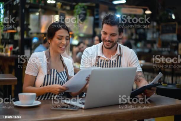 Staff doing the books at a restaurant picture id1160806093?b=1&k=6&m=1160806093&s=612x612&h=q2xyg80nttnl2bd2tbhykwblvkchppjl5ybjikd68bo=